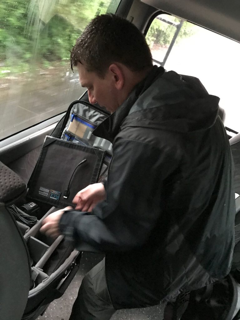 David packing video gear in the van on a trip to El Salvador with Compassion International